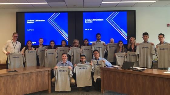 National Grid interns holding up their gridterns teeshirt