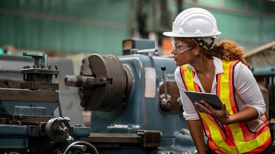 Woman inspecting machinery
