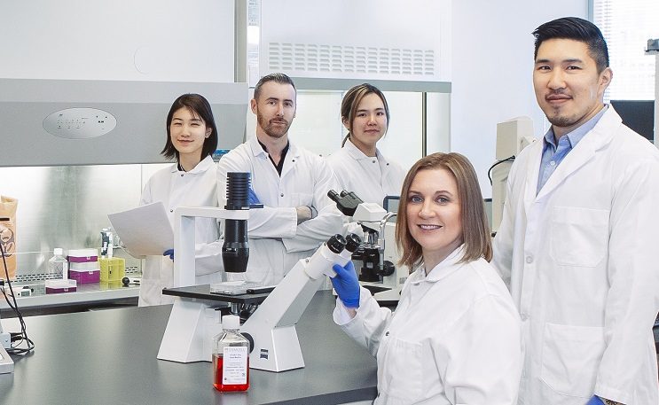 Group of people in a science lab