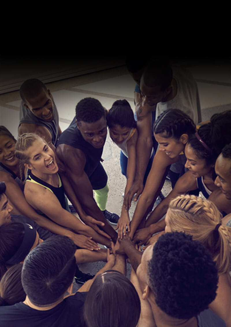 Nike employees in a sports huddle