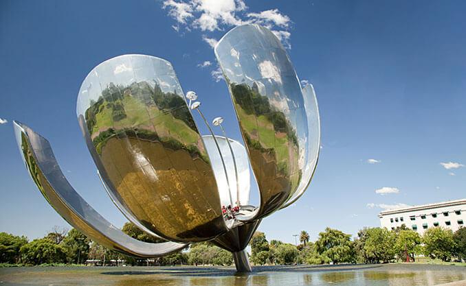 big metal flower looking object in water