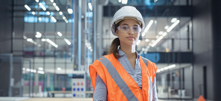 A young woman wearing safety gear.