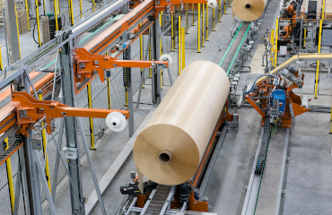 A roll of non-woven fiberglass fabric on the factory floor