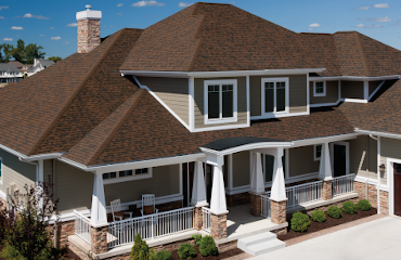 Brownwood Duration shingles on a beige Craftsman-style home